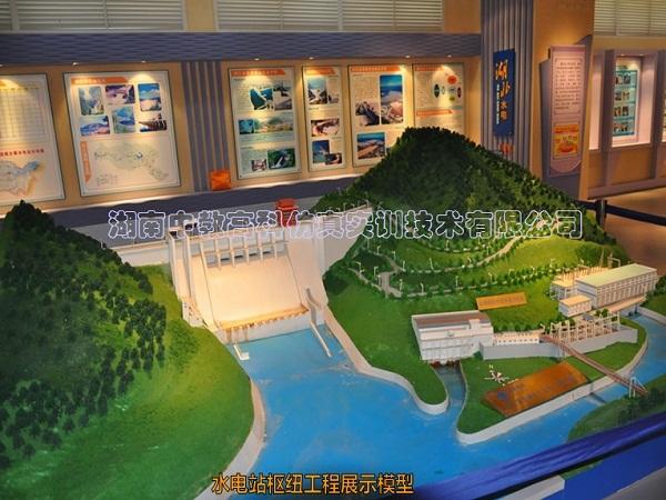ZJGKSD04-水电站库区沙盘模型 根据水利枢纽工程水电站库区布置图设计;模型能展示库区电站地形、地貌和大坝枢纽整体布置。 1、水电站库区山体地形严格按地形图上的等高线,按比例进行缩放,采用玻璃钢制模浇注成形,表现山峰、谷地、悬崖、洼地等,浇注新形模型材料反应出地貌的各种颜色。整个山体不但形成一个整体结构,牢固耐久、不开裂、不退色,抗蚀、防潮,而且形体、色泽逼真。 2、建筑物采用进口珠光有机板材,激光雕刻机成形。电站主要建筑物按比例制作。 电站枢纽模型内容:拦河坝,泄水建筑物,冲沙建筑物,消能建筑物,引